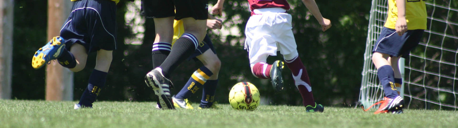 Waist-down photo of players racing for the ball.