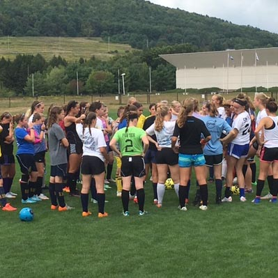 Players huddle before tryouts begin