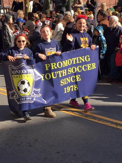 OSC players take part in a parade